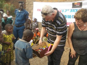 Man handing out toy cars