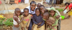 Aline posing a with a group of young children