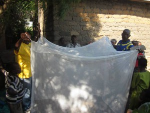 Wings of Hope for Africa distributes mosquito netting as a part of an anti-malaria education project