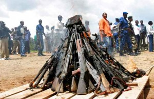Weapons being burnt in a pile