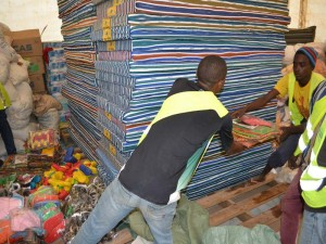 People passing off donated goods to one another