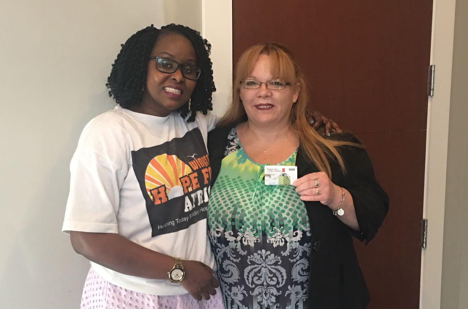 Aline awarding a gift card to Deanna