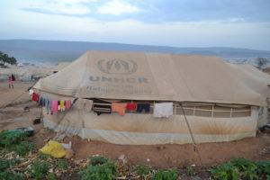 A beige UNHCR tent